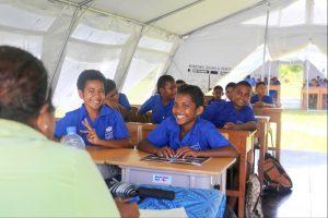 Fijian school children in tent classroom. Photo DFAT Public Affairs Suva