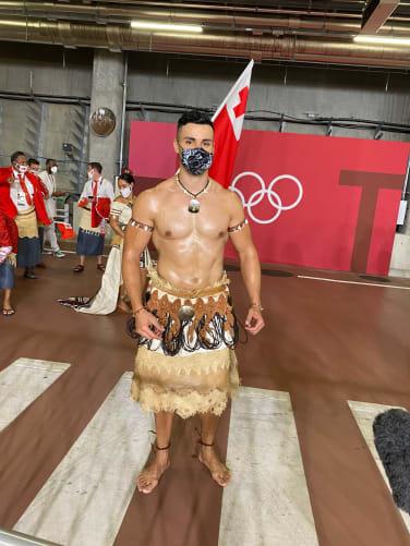 Tonga's flag bearer, Pita Taufatofua